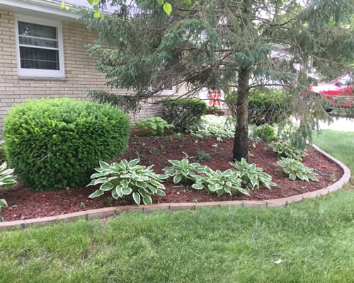 Mulching Flower Bed Maintenace Service Hartford Wi At Home